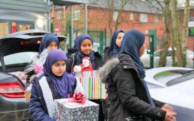 Pupils spread festive cheer among Birmingham's elderly