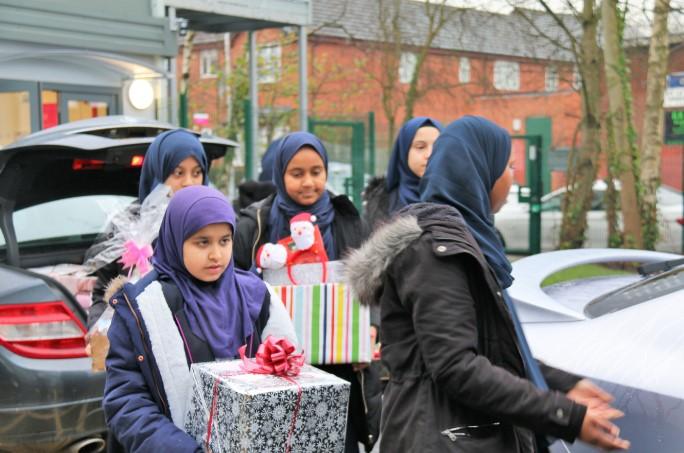 Pupils spread festive cheer among Birmingham's elderly